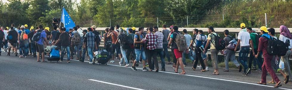 1024px-Refugee_march_Hungary_2015-09-04_02.jpg