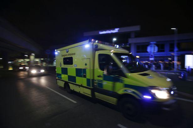 An-Ambulance-drives-past-Londons-City-A.jpg