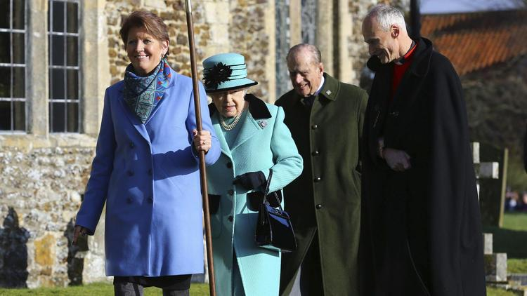 and her husband Duke of Edinburgh, center, arrive at St. Peter and St. Paul at West Newton, England, on Feb. 5, 2017.jpg