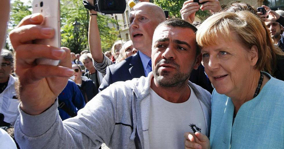 Angela-Merkel-Migrant.jpg
