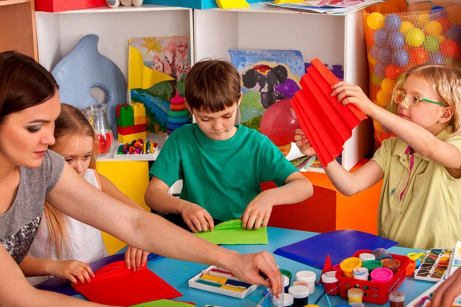 bigstock-School-children-with-scissors--189687040.jpg