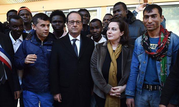French president François Hollande and housing minister Emmanuelle Cosse at a reception centre in Doue-la-Fontaine on Saturday..jpg