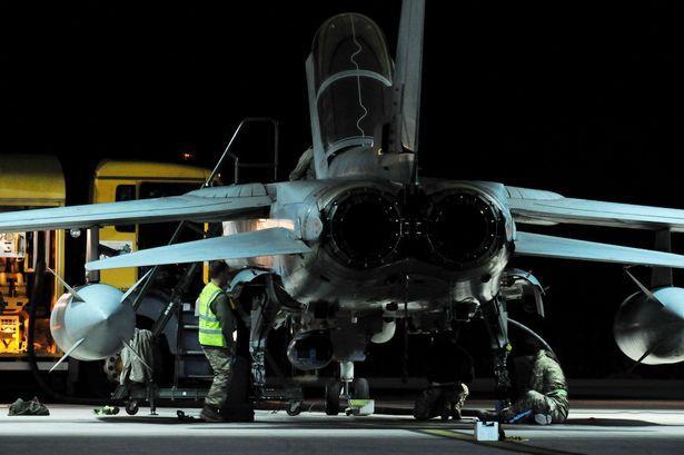 Ground crew work on a RAF Tornado GR4 after it returned to RAF Akrotiri in Cyprus.jpg