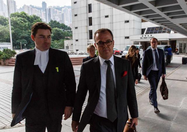 Lawyer Michael Vidler (front centre), British forensic psychiatrist Richard Latham (right) and British psychologist Derek Perkins.jpg