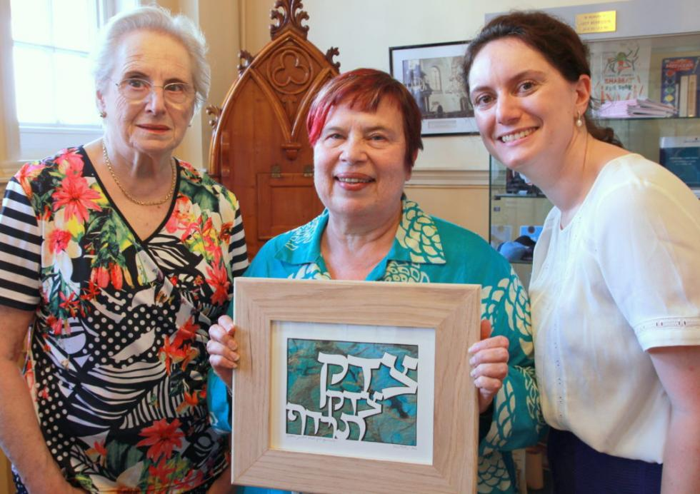 Louise Freedman and Alice Alphandary present Rabbi Janet Darley (centre) with a leaving gift.jpg