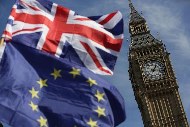 PROD-An-EU-flag-and-a-Union-flag-held-by-a-de.jpg
