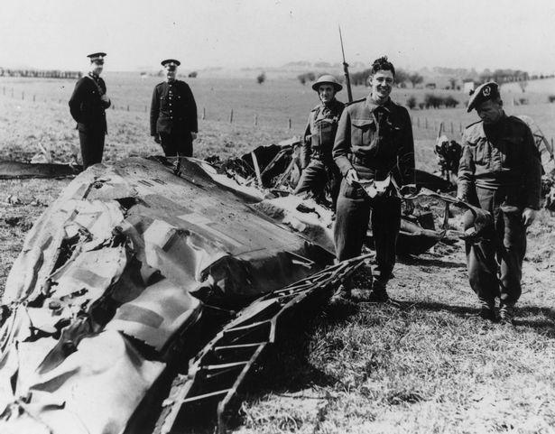 Soldiers and policemen in Eaglesham inspect the wreckage of the Messerschmitt ME-110 in which Nazi leader Rudolf Hess made his solo flight to Scotland.jpg