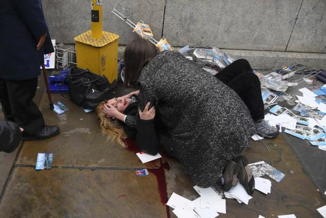 woman-lies-injured-shotting-incident-westminster-bridge-london.jpg